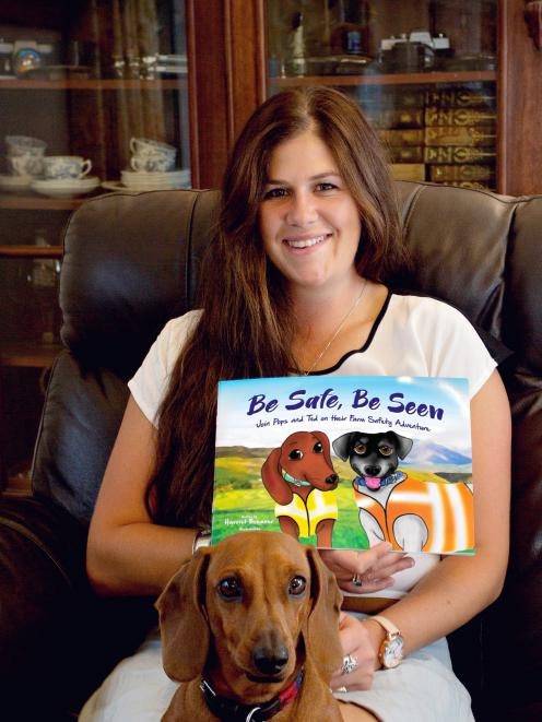 Harriet Bremner, pictured with Poppy the miniature dachshund, has written a book about farm...
