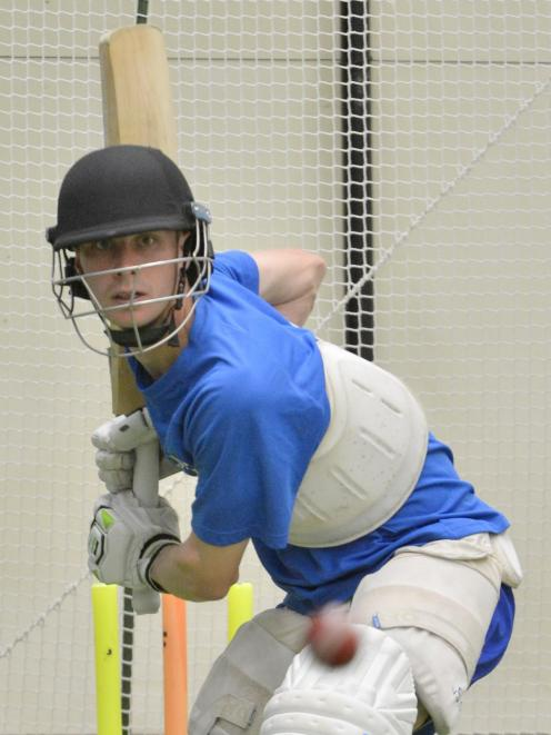 Otago rookie opener Cam Hawkins keeps his eye on the ball during a net session at the Edgar Centre earlier this week. Photo: Gerard O'Brien