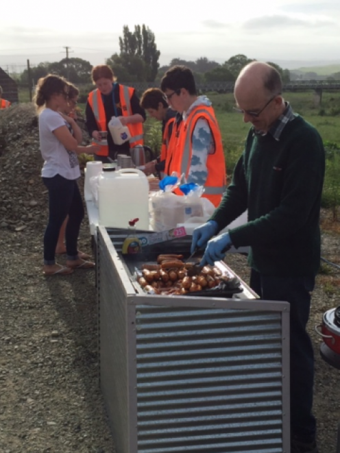 Police have been taking the opportunity to talk to road users about fatigue and distractions while feeding them barbecue food and coffee. Photo: NZ Police