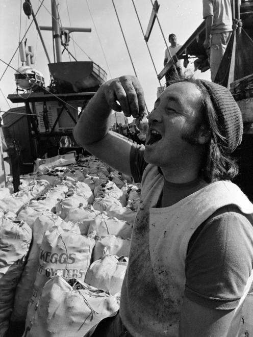 Terry Osborne, of Bluff, samples the delicacy as the first boat unloaded at the port at the start...