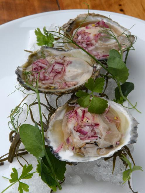 Fresh Bluff oysters with chardonnay shallot vinaigrette prepared by Vault 21 executive chef Greg...