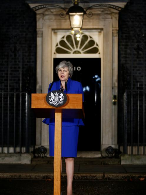Theresa May makes a statement back at Number 10 Downing Street after winning the confidence vote....