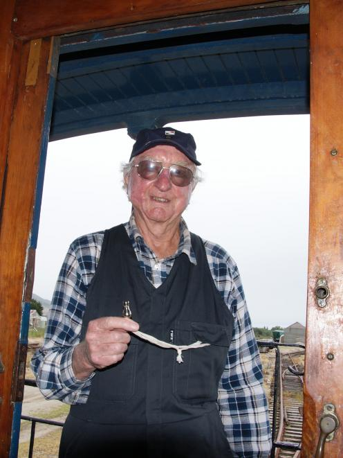 Whistle-blower George Gardner with his historic whistle on the train at Mandeville. Photo: Alina...