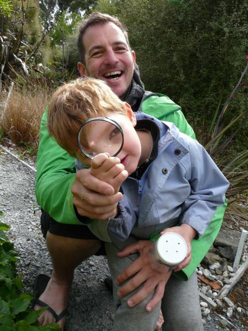 Jake (5) and father Gareth Hallam, of Christchurch, hunt for bugs during the South Otago Kiwi...
