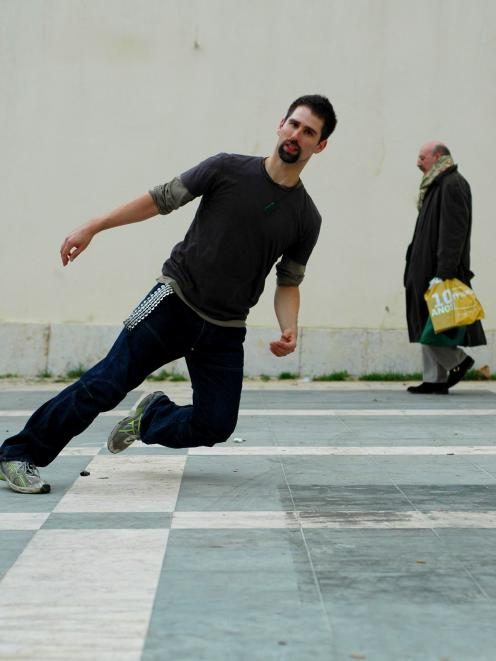 Onarheim-Smith performs for Portuguese photographer Pedro Gomez, in a public square in Lisbon. Photo: Supplied