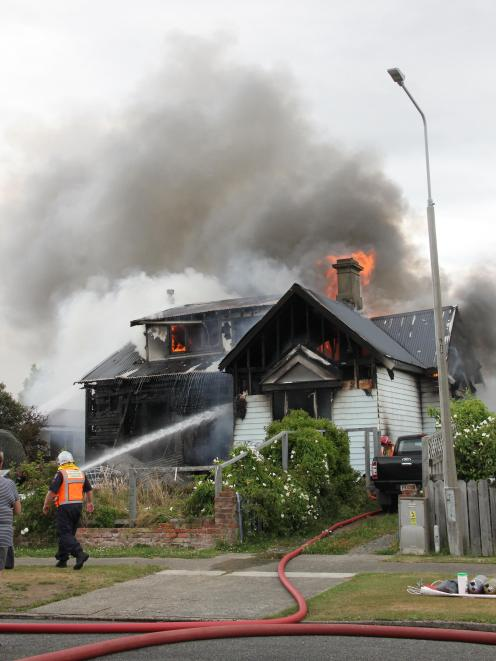 Crews battle the blaze in Invercargill this afternoon. Photo: Corrina Jane Photography
