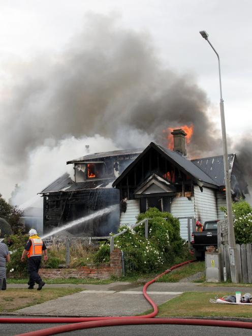 The Gordon St house on fire on Tuesday. Photo: Corrina Jane Photography