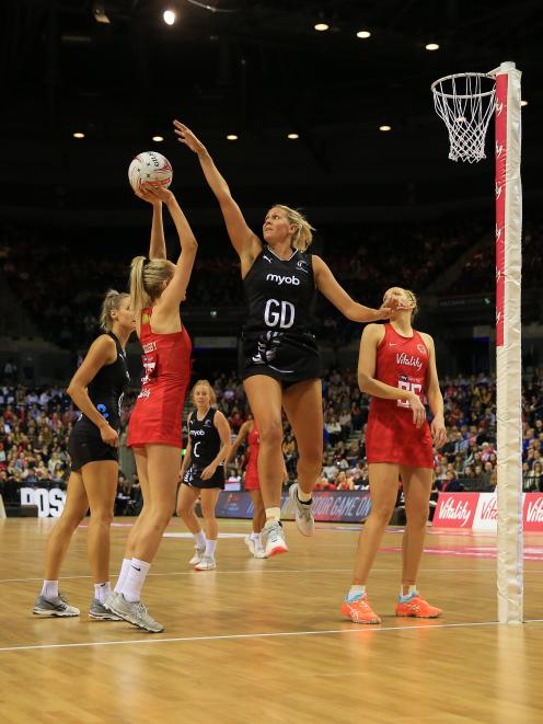 Helen Housby of England Roses lines up a shot challenged by Casey Kopua of the New Zealand Silver...