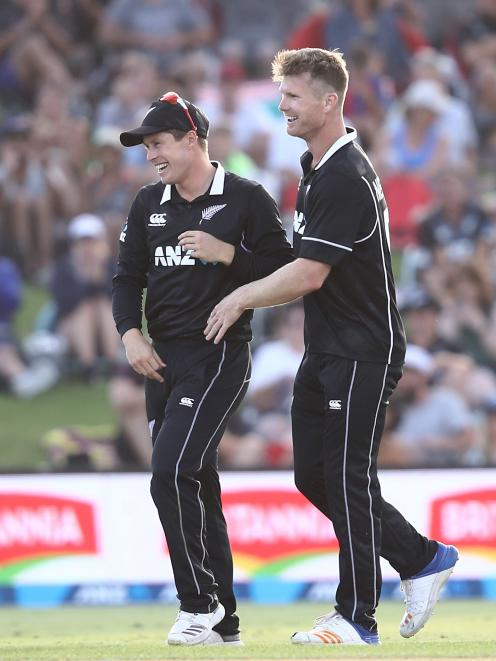 James Neesham (right) enjoyed a happy return to the Black Caps, smashing 47 off 13 balls and...