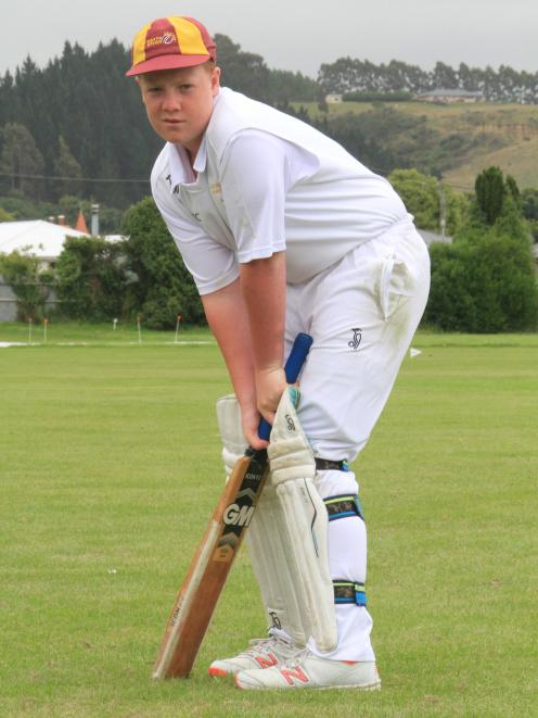 Toby Growcott (13) prepares to face the bowler.