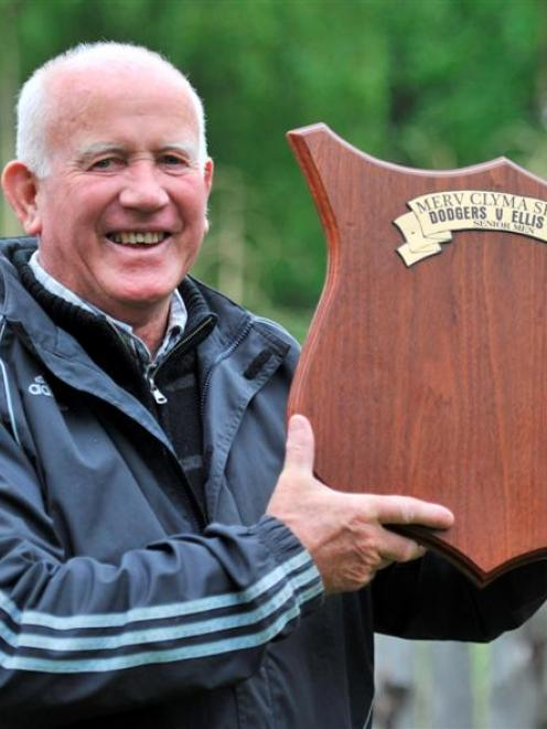 Otago softball great Merv Clyma holds the shield in his name that will be contested today for the...