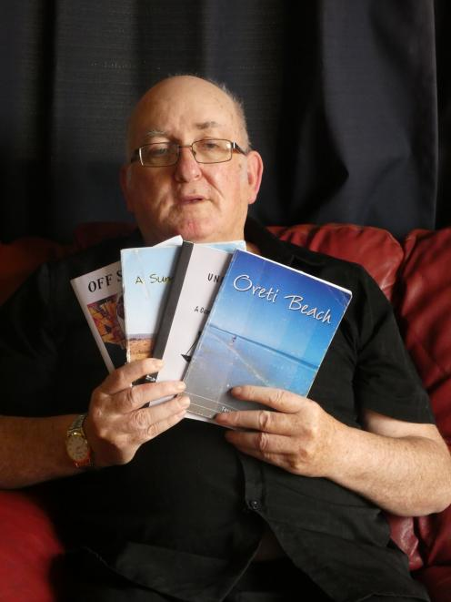 Invercargill poet Terry Lynch with some of his published books of poetry. Mr Lynch uses his battles with mental health problems to teach others to use artistic expression to cope with their own mental health issues. Photo: Ben Waterworth