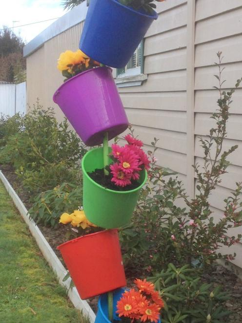 Stacked buckets in a Dunedin Garden.