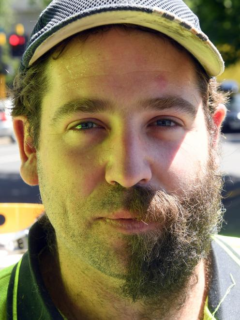 Hayward College contractor Todd Hendry poses halfway through a beard trim.