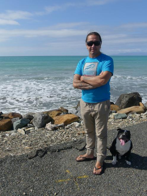 James York and his dog Mana on the Colac Bay foreshore.