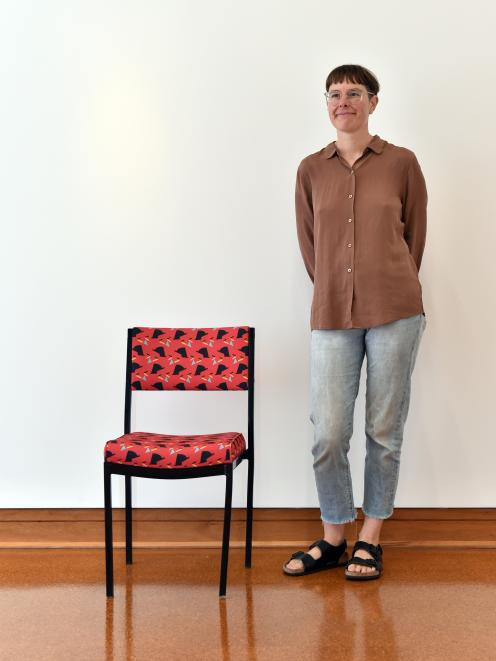 2018 Frances Hodgkins Fellow Louise Menzies with one of the office chairs she has re-covered in a fabric based on Frances Hodgkins textile designs. Photos: Gregor Richardson