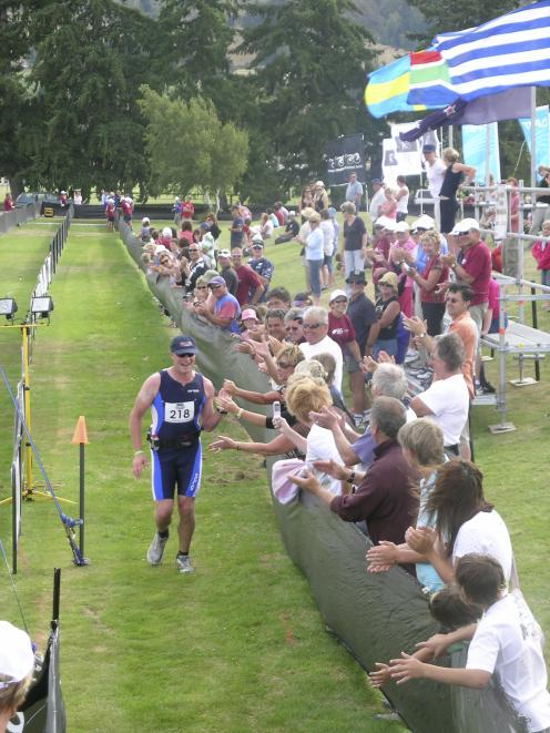 Wanaka GP Andrew McLeod is greeted by a small crowd during the run transition of the first...