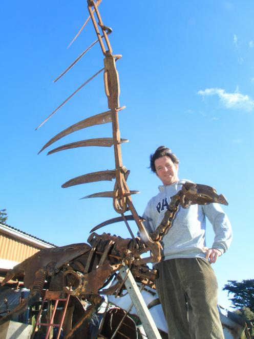 North Otago artist Matt King's life-size 3m found-metal sculpture of a Haast's eagle is complete and now waiting on an engineer's report before it is positioned above his found-metal moa at the brewery hole in Duntroon. Photo: Hamish MacLean