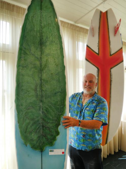 Riverton artist Wayne Hill poses with some of his work at his latest exhibition. PHOTO: BEN...