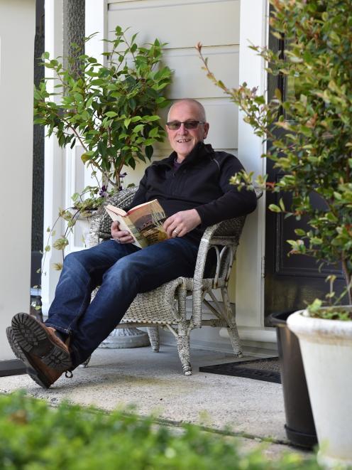Co-owner Rex Johnston relaxes on the front veranda.