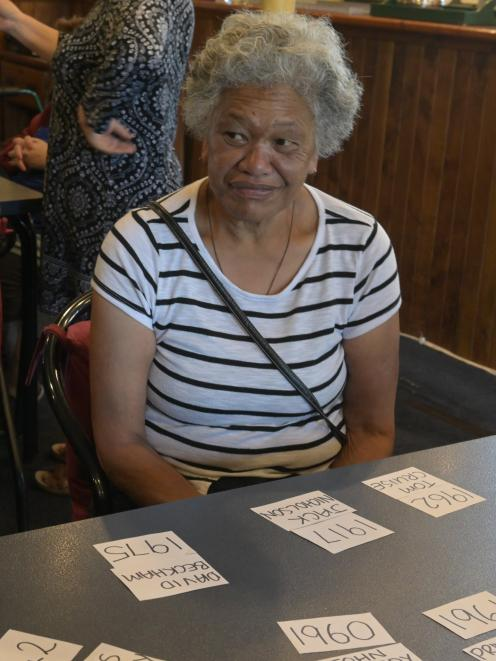 Makarita Huihui watches as her friends debate the options in a trivia game played at the Senior...