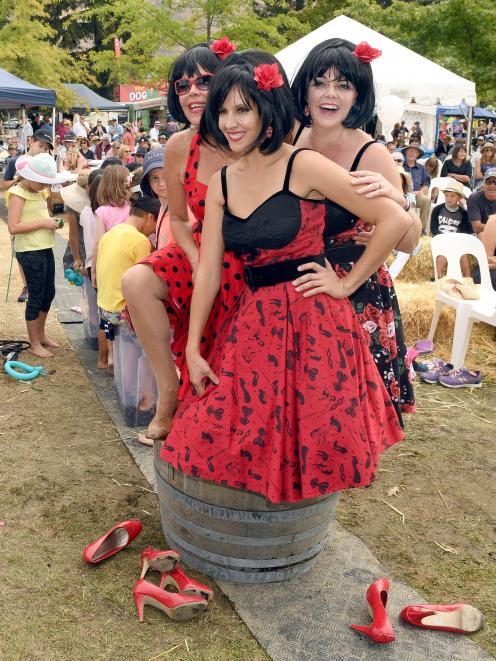 The Beat Girls (from left) Andrea Sanders, Kali Gazley and Narelle Ahrens stomp on grapes as part...