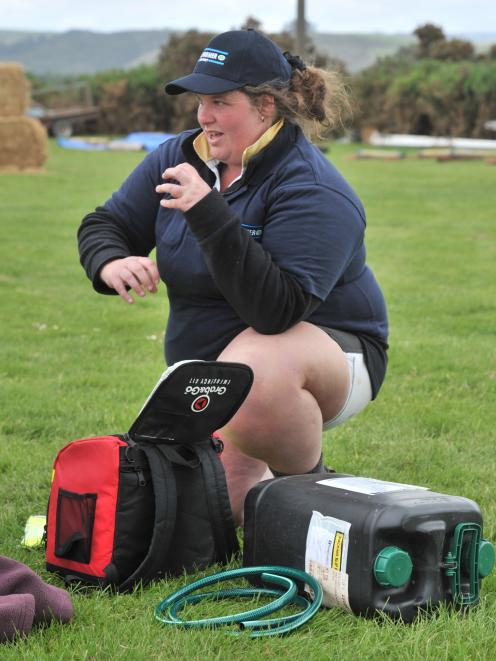 Bridget Henderson takes part in the first aid section in the Young Farmer of the Year district contest in Milton in 2014. Photo: Linda Robertson