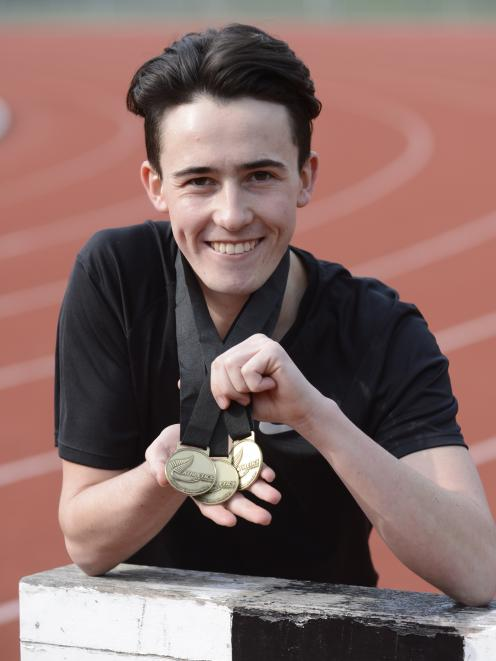 Oli Chignell (20) at the Caledonian Ground yesterday with his three national championship gold medals from this year. Photo: Gerard O'Brien