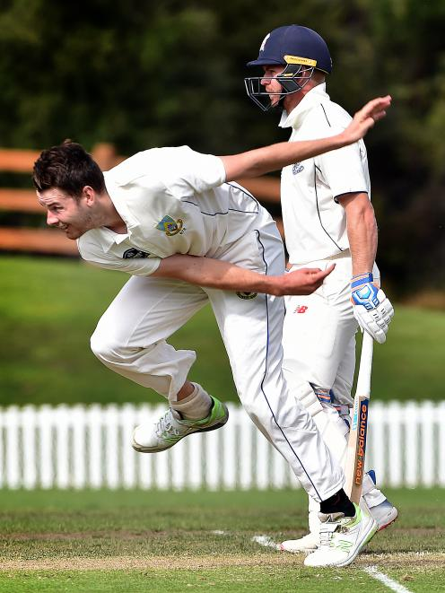 Otago Volts co-captain Jacob Duffy bowls at the University of Otago Oval as Auckland batsman Glenn Phillips looks on during play on day two of their Plunket Shield game yesterday. Photo: Peter McIntosh