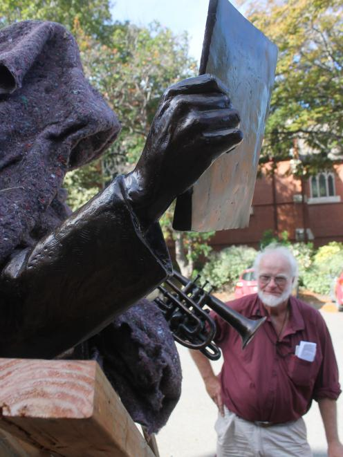 Historian Lloyd Esler looks at the partly unveiled statue of Alex Lithgow. PHOTO: JANETTE GELLATLY