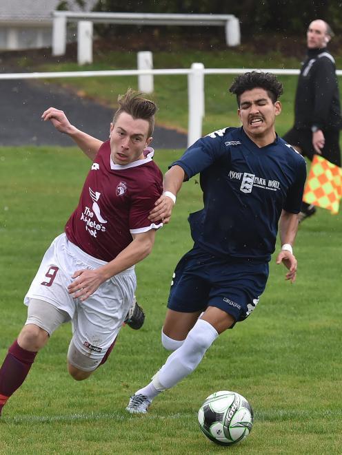 Dunedin Technical's Rhys Quarrell (left) and Southland United's Angel Alberto Garcia dispute...