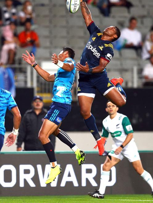 Waisake Naholo challenges for a high ball during the Highlanders' loss to the Blues at Eden Park...