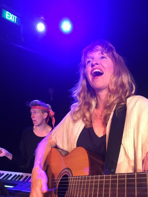 Lisa Brickell (front) performs with the show's composer Sarah Macombee.