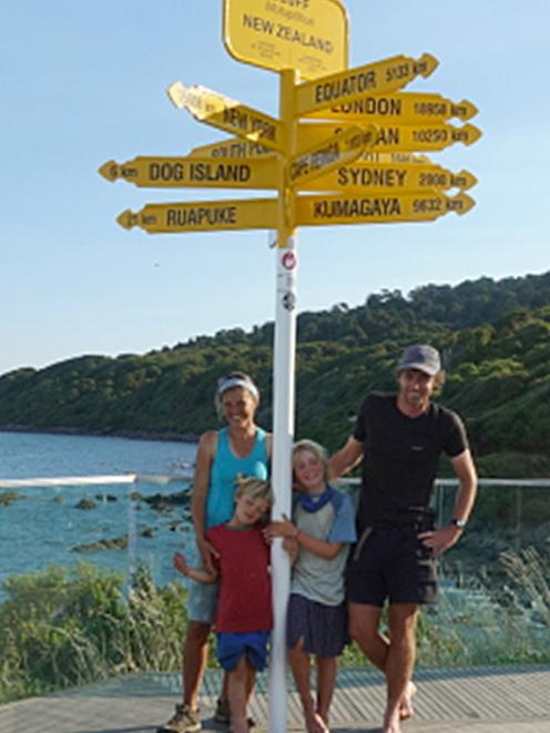 The Rapsey family (from left) Jorinde, Jonathan, Elizabeth and Chris stand beneath the signpost...