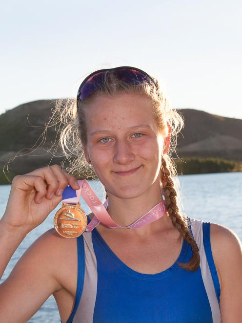 Eva Hofmans, of the Otago Rowing Club, shows off her gold medal won in the women's senior single...