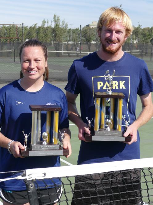 Libby Scott and Ryan Eggers hold the player of the year trophies they received at the Otago...