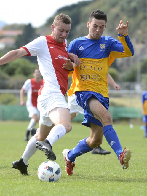 Caversham's Connor Neil (left) and University's Thomas Sule tussle for the ball in a Southern...