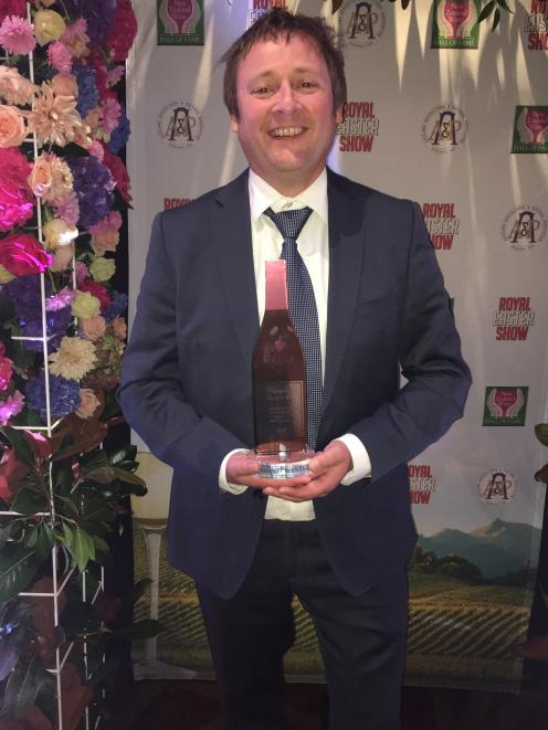 Wild Earth Wines' market and sales manager Elbert Jolink was thrilled when their Wild Earth Reserve Earth and Sky Pinot Noir 2014 won the best pinot noir trophy at the Royal Easter Show Wine Awards dinner earlier this month. Photo: Supplied