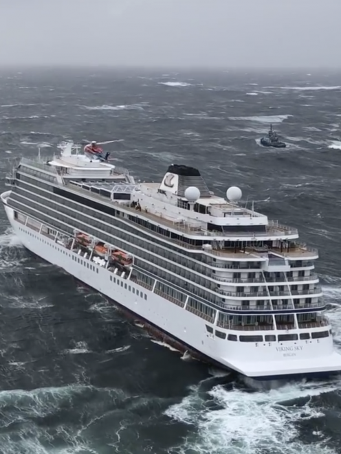 In this image taken from video made available by CHC helicopters, helicopters fly over the cruise ship Viking Sky after it sent out a Mayday signal. Photo: CHC helicopters via AP