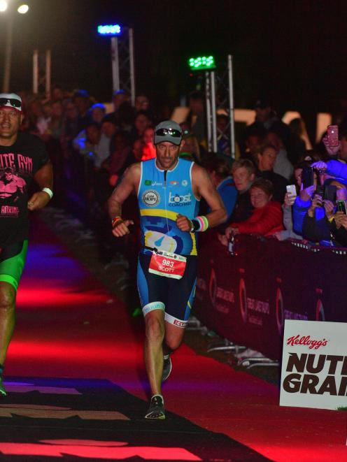 Brighton triathlete Scott Weatherall is nearing the end of the Ironman race in Taupo on Saturday....