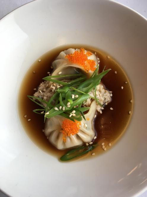 Prawn and pork dumplings are served in a chicken broth with eggplant puree, green bean and sesame...