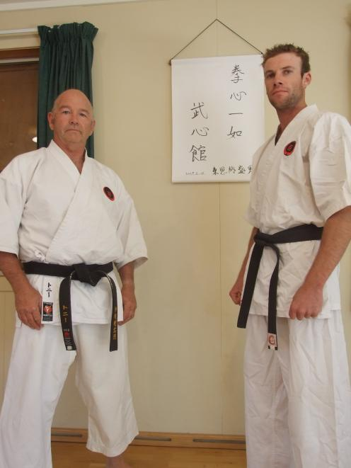 Following a morning shift on the Gimmerburn farm Tony Clarke (left) and Matt Larson don the...