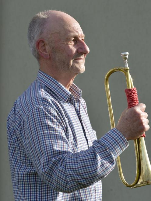 Russell Atkinson with his trusty bugle, following his last performance of the Last Post and...