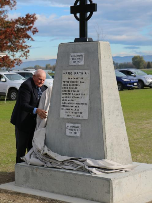 Alan Fowler, of Wendon, unveils the new Wendon War Memorial, north of Gore, yesterday. The...