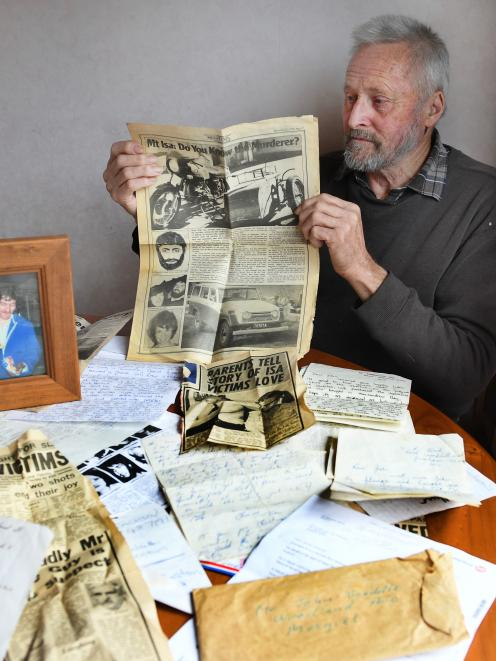 John Twaddle (69), of Mosgiel, holds a newspaper featuring an article on the cold case murder of his brother Gordon, his  friend and a woman. Australian police on Friday arrested a suspect after more than 40 years. Photo: Stephen Jaquiery