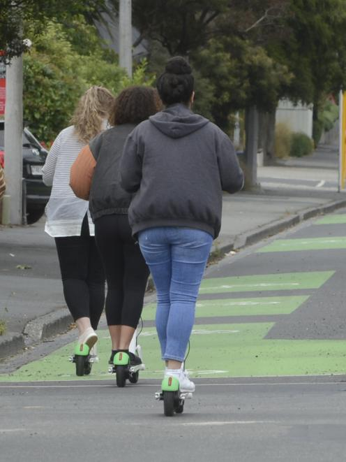 A small group of Lime scooter riders make their way down the Cumberland St cycleway. Photo:...