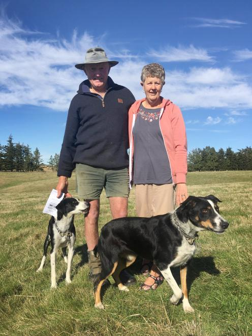 Warren and Wendy MacLeod, with Rose and Neave, at the Macraes Collie Club's trials at Moonlight...