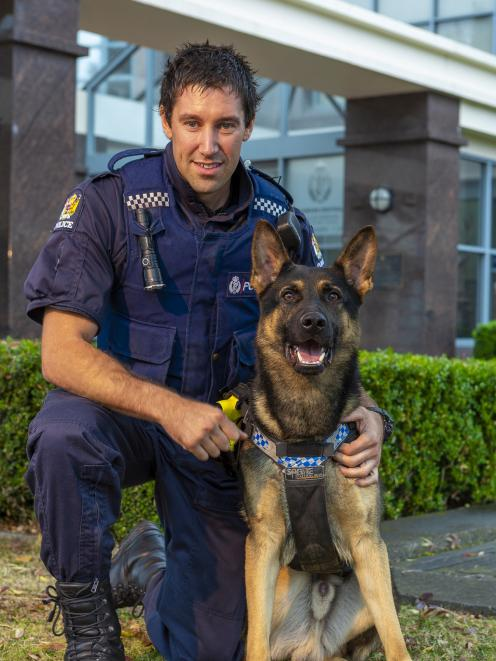 Constable Marcus Saunders and patrol dog Vann outside the Dunedin Central Police Station. Photo: Supplied
