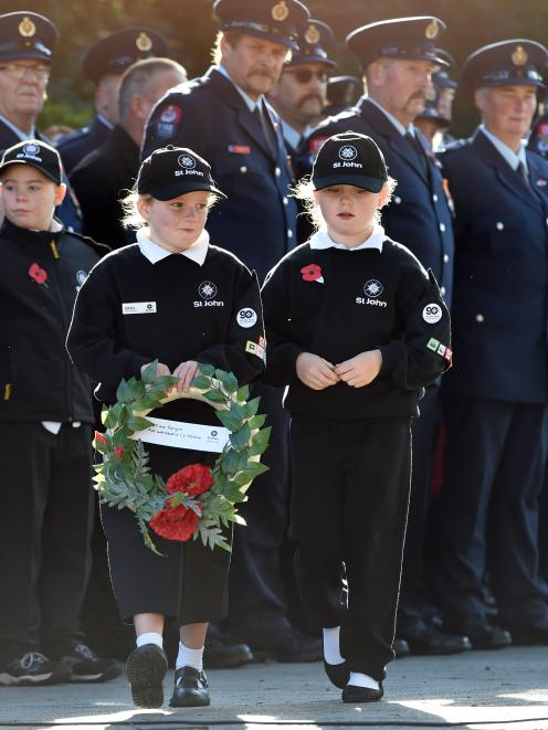 Ashley White (8),left and Sophia Thomson (7) of St Johns Mosgiel during the Mosgiel Anzac Day...