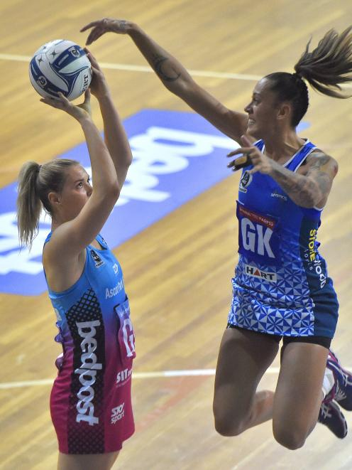 Southern Steel goal shoot Lenize Potgieter calmly lines up a goal as Northern Mystics goal keep Erena Mikaere defends during an ANZ Championship match at the Edgar Centre in Dunedin last night. Photo: Gregor Richardson